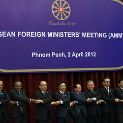 Association of Southeast Asian Nations, or ASEAN Secretary General Surin Pitsuwan, far right, holds hands with ASEAN foreign ministers in traditional group photo session at the start of their meeting in Phnom Penh, Cambodia Monday, April 2, 2012. The ministers are from left, Wunna Maung Lwin of Myanmar, K. Shanmugam of Singapore, Surapong Tovichakchaikul of Thailand, Pham Bihn Minh of Vietnam, Hor Namhong of Cambodia, Lim Jock Seng of Brunei, Marty Natalegawa of Indonesia, Thongloun Sisoulith of Laos, Anifah Aman of Malaysia.