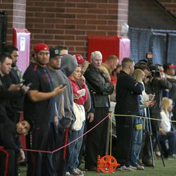 A crowd watch as NFL hopefuls do drills for pro scouts during Utah pro football day at the University of Utah Wednesday, March 19, 2014, in Salt Lake City.