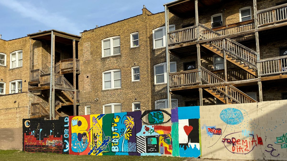 This mural, painted on wall outside apartments near Division Street and Springfield Avenue., was designed and mostly done by middle school students.