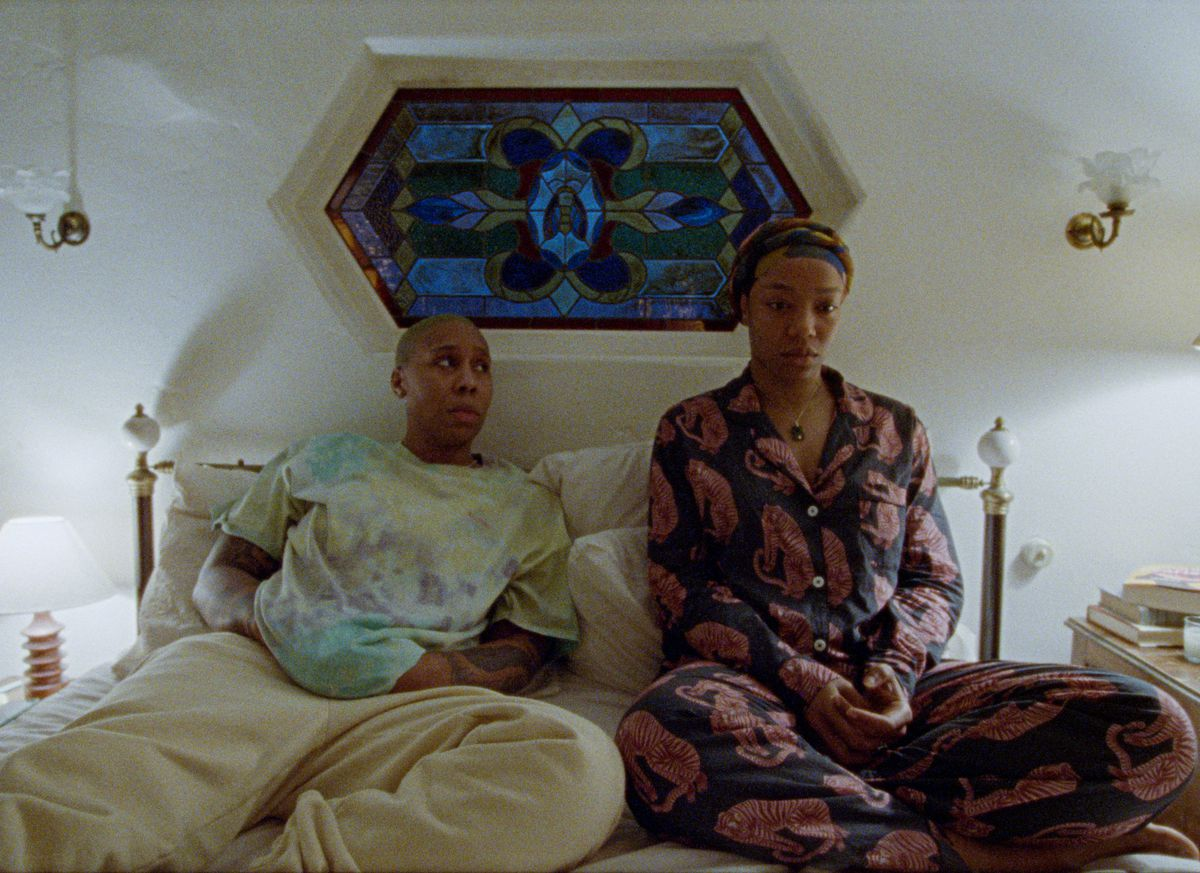 Naomi Ackie and Lena Waithe sit in bed together in Master of None season 3