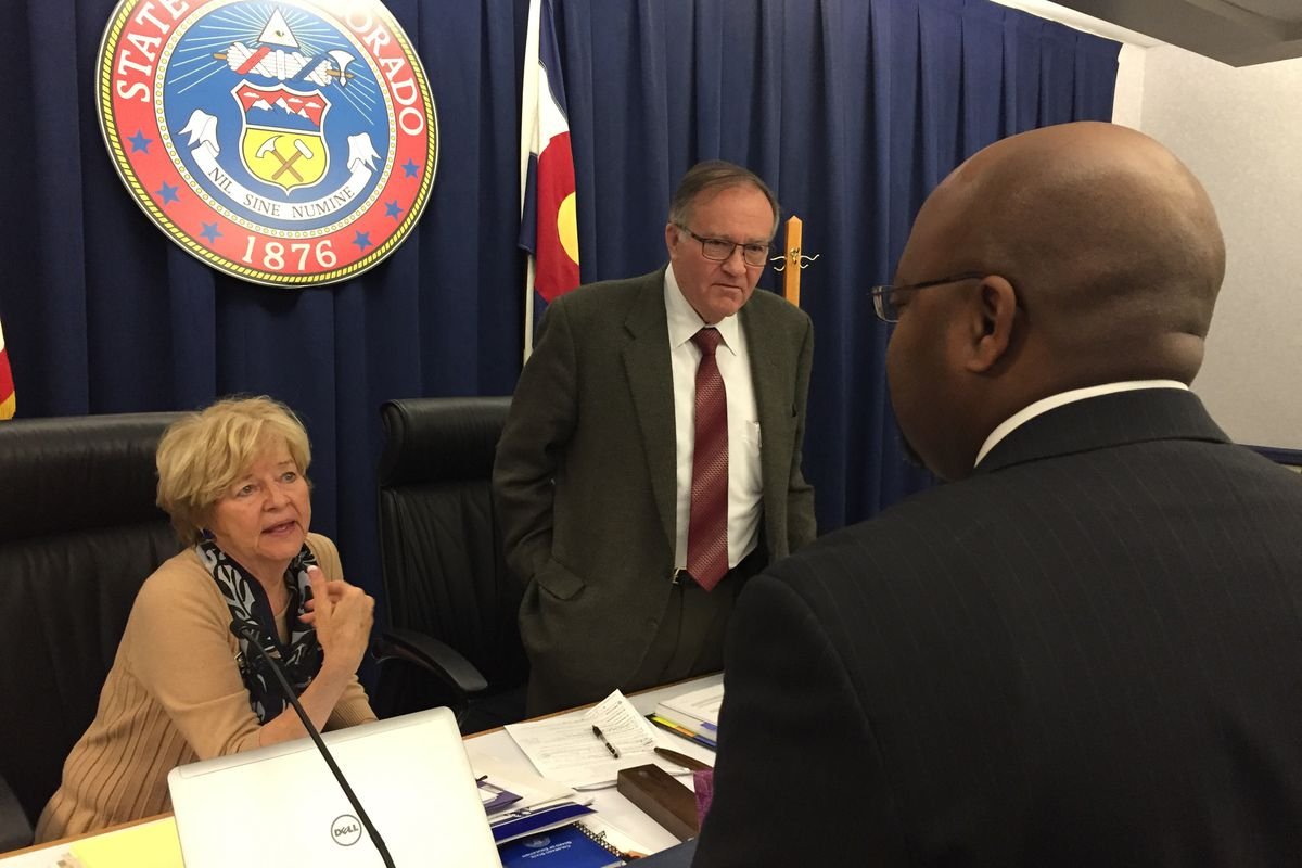 State Board of Education chairman Steve Durham, center, and vice chair Angelika Schroeder meet with Aurora Public Schools Superintendent Rico Munn in May 2015.
