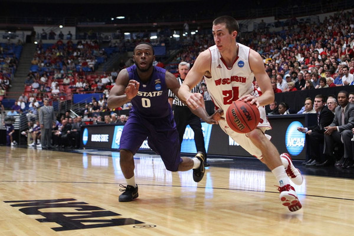 Josh Gasser found plenty of holes in Kansas State's interior defense, coming up with 11 points and the game-clinching free throws as Wisconsin held off the Wildcats 70-65.