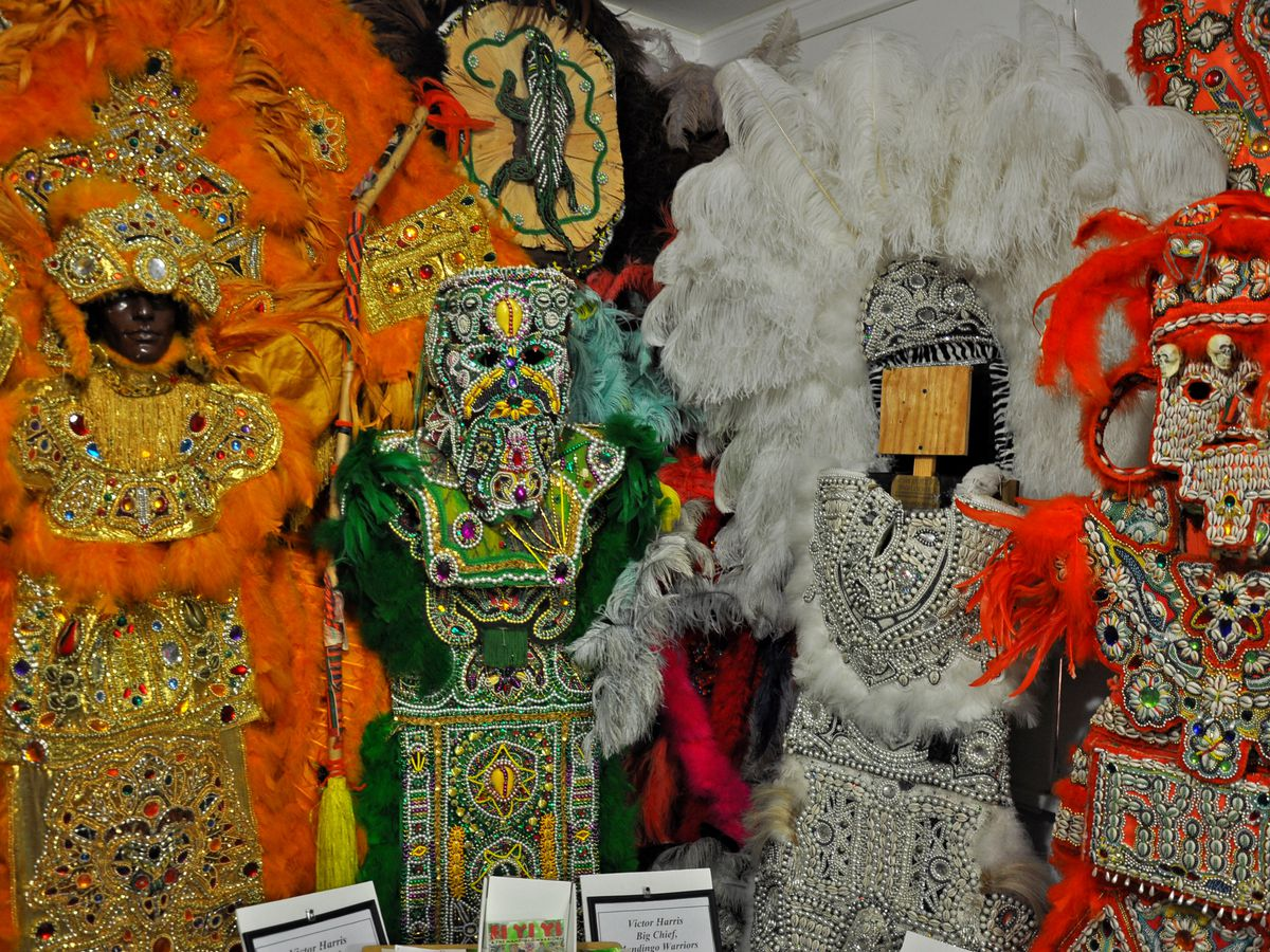 Mardi Gras Indian costumes at the Backstreet Cultural Museum. The costumes are colorful with large headdresses.
