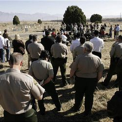 Salt Lake County Sheriff's deputies dedicate a headstone for deputy James D. Hulsey, who was killed in the line of duty in 1913. The ceremony Monday was held in the Bingham City Cemetery.