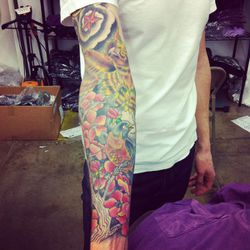 Head of Operations Daniel Rosen's colorful tatts feature the state bird and flower of Michigan, where he's originally from.