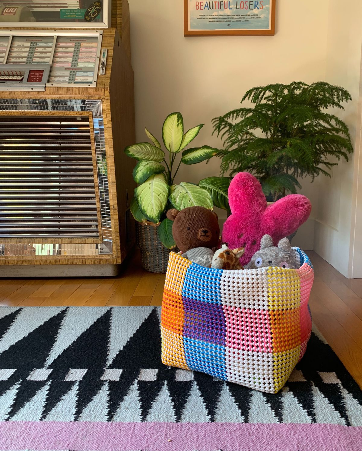 Colorful basket filled with stuffed animals.