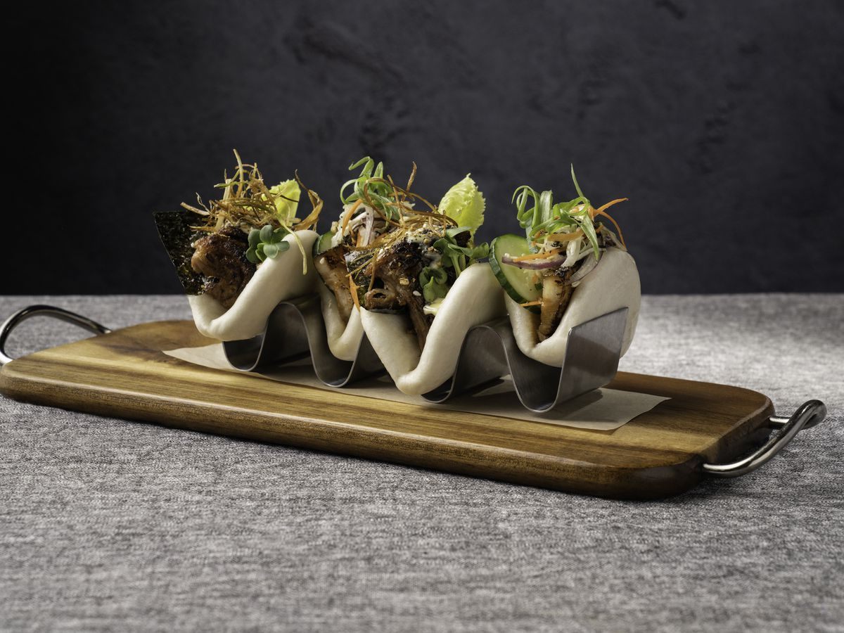 The bao on a wooden cutting board