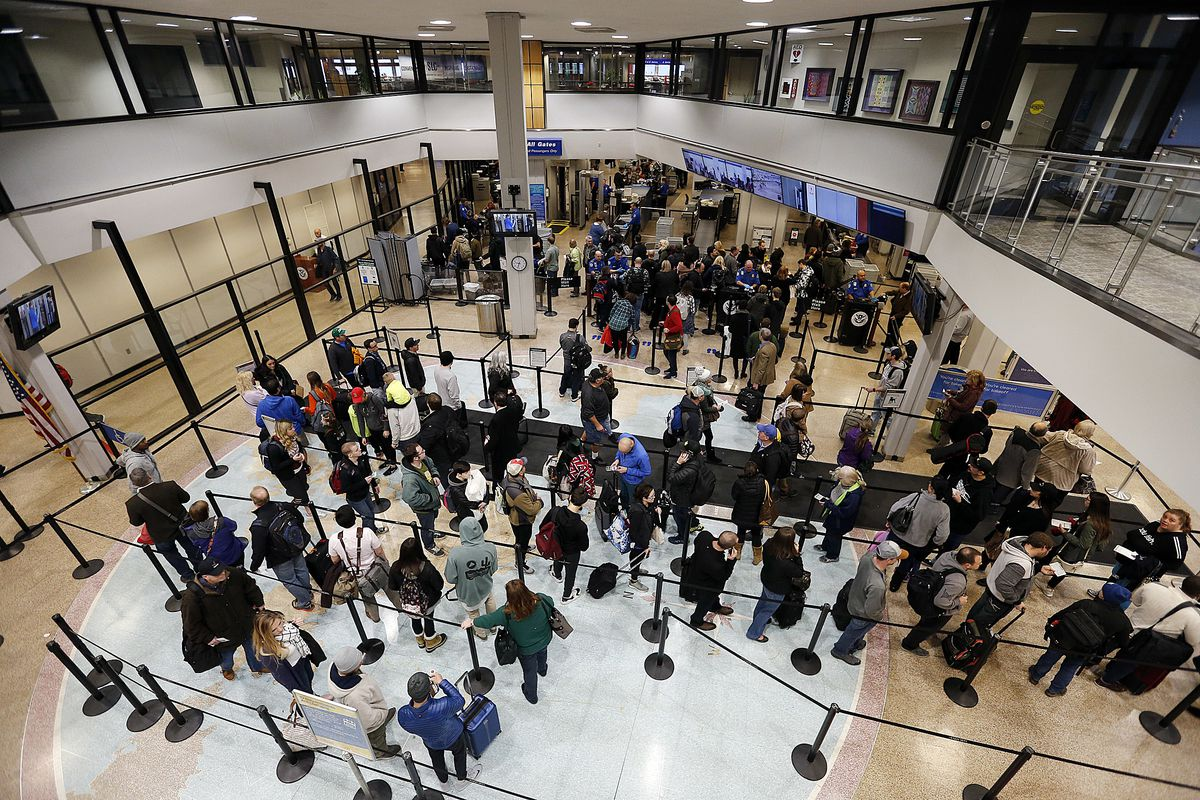 Travelers make their way through security at the Salt Lake City International Airport on Monday, Jan. 8, 2018. According to a tweet from the airport, 17 flights were cancelled during the morning due to the heavy fog.