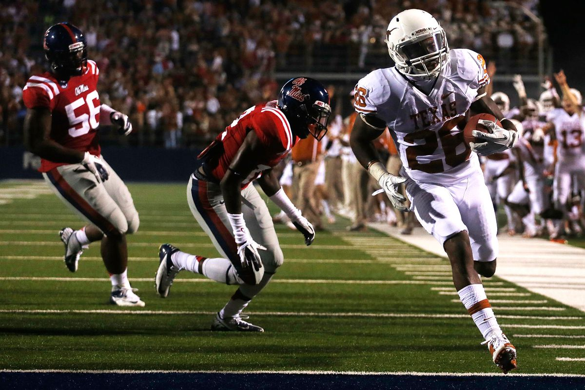 OXFORD, MS - SEPTEMBER 15:  D.J. Monroe #26 of the Texas Longhorns scores a third quarter touchdown against the Ole Miss Rebels at Vaught-Hemingway Stadium on September 15, 2012 in Oxford, Mississippi.  (Photo by Scott Halleran/Getty Images)