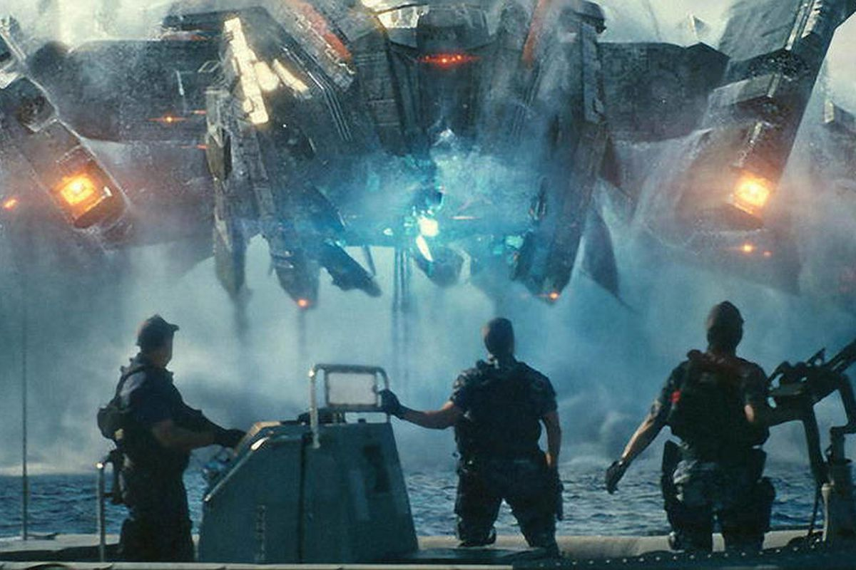 """In this film publicity image released by Universal Pictures, from left, John Tui, Taylor Kitsch and Rihanna are shown in a scene from """"Battleship.""""  The Hasbro Inc. game using plastic pegs and ships was once a way for kids to while away lazy summer aftern"""