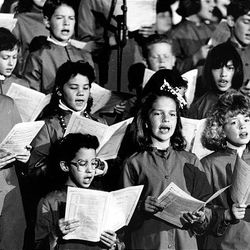 A children's choir sings at a holiday religious service Nov. 23, 1991.