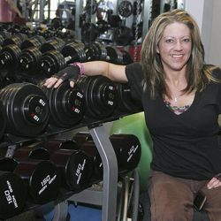 ADVANCE FOR USE SUNDAY, APRIL 22 AND THEREAFTER - In this photo taken April 9, 2012, Cindi Johnson, a competitive body builder, is seen where she works out at Premier Fitness in Rockford, Ill. Johnson was diagnosed in 2005 with multiple sclerosis, myelopathy and a degenerative disc disease. Because of her limited mobility, she uses a wheelchair. She is preparing to compete in the NPC Grand Prix Natural, Bodybuilding, Figure, Physique, Bikini & Wheelchair Championships to be held in Rockford in May.