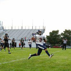 Payton's Damien Goodman (3) scores a touchdown against Clark.