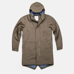 """<strong>Surf Saturdays</strong> Nathan Rain Parka in Olive, <a href=""""http://www.saturdaysnyc.com/item/nathan"""">$325</a>"""