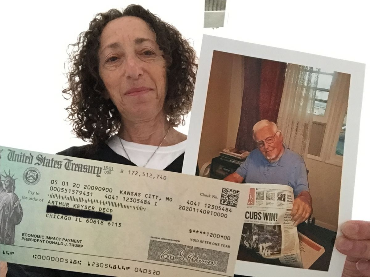 Janet Williams, of Roscoe Village, shows the $1,200 federal stimulus check made out to her late stepfather, Arthur Keyser. Photo retouched to obscure some address information.