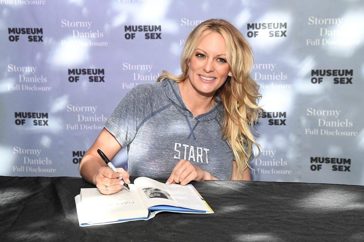 Stormy Daniels signs copies of her book Full Disclosure on October 8, 2018