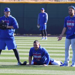 Victor Caratini (our left) and non-roster invitee Francisco Arcia (our right) surround Willson Contreras (bottom-middle) on Field 2 at Riverview Park, the Spring Training home of the Chicago Cubs, in Mesa, AZ.   John Antonoff/For the Sun-Times