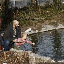 Blair Christensen and Kristan Warnick feed the ducks with their son Seth in Salt Lake City Thursday, Jan. 21, 2016.