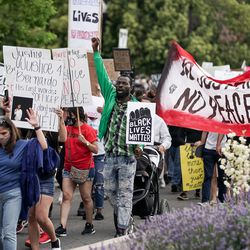Protesters march along 300 South in Salt Lake City on Saturday, June 13, 2020. The day's demonstrations were the latest in ongoing protests against racism and police brutality that have followed the killing of George Floyd in Minneapolis.