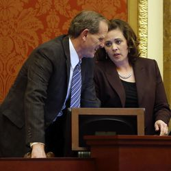 House Majority Leader Brad Dee, R-Ogden and House Speaker Becky Lockhart, R-Provo, talk during the last night of Legislature at the Capitol in Salt Lake City on Thursday, March 13, 2014. Lockhart, the first woman to serve as Utah House speaker, died at her home Saturday, Jan. 17, 2015, from an unrecoverable and extremely rare neurodegenerative brain disease. Lockhart she was 46.