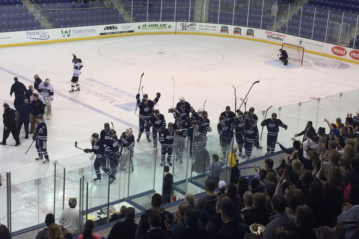 St. John's Prep players celebrate their upset of Springfield Cathedral in the Super 8 semifinals at the Tsongas Center.