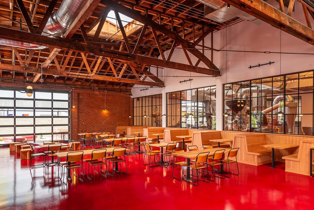 A warehouse-like restaurant space with a bright red floor.