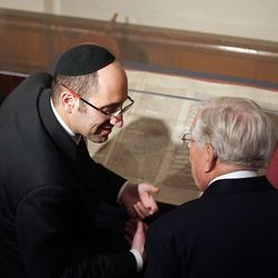 Rabbi Meir Y. Soloveichik, left, talks with President M. Russell Ballard, acting president of the Quorum of the Twelve Apostles of The Church of Jesus Christ of Latter-day Saints, as they look at Torah scrolls at the Spanish and Portuguese Synagogue of the Congregation Shearith Israel in New York City on Friday, Nov. 15, 2019.