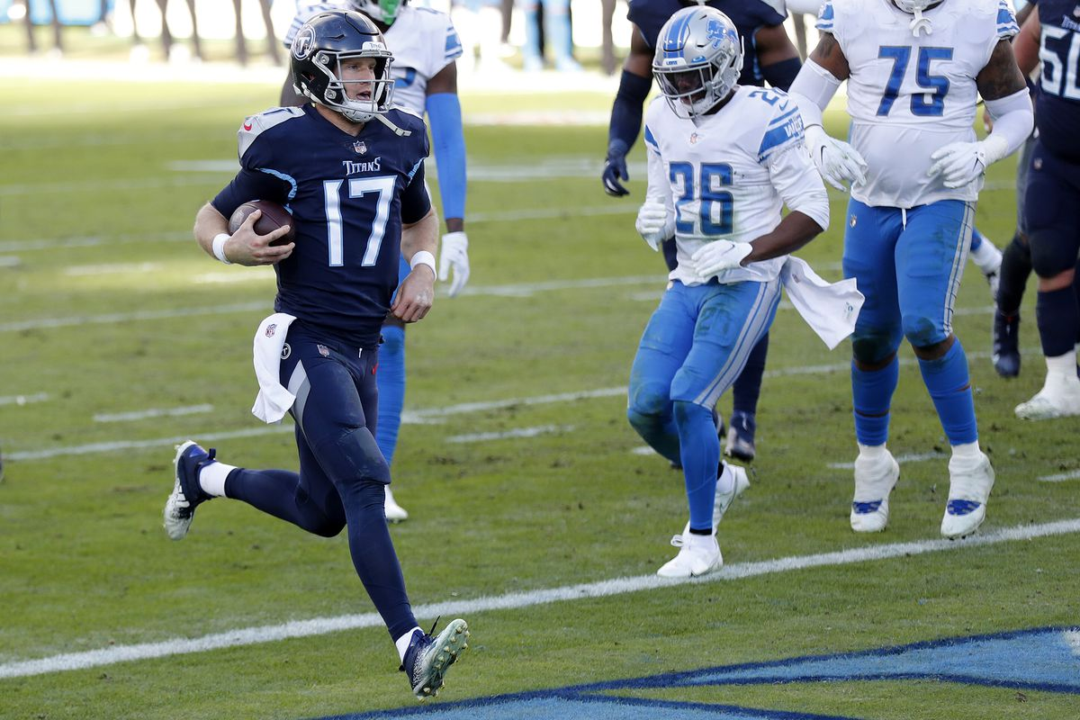 Quarterback Ryan Tannehill #17 of the Tennessee Titans rushes for a touchdown during the fourth quarter of the game over the Detroit Lions at Nissan Stadium on December 20, 2020 in Nashville, Tennessee.