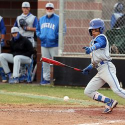 Layton and Bingham play a baseball game in Layton on Tuesday, March 23, 2021.