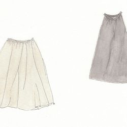 Left to right: Cotton gathered skirt in taupe, $180. Cotton pear top in charcoal, $160.