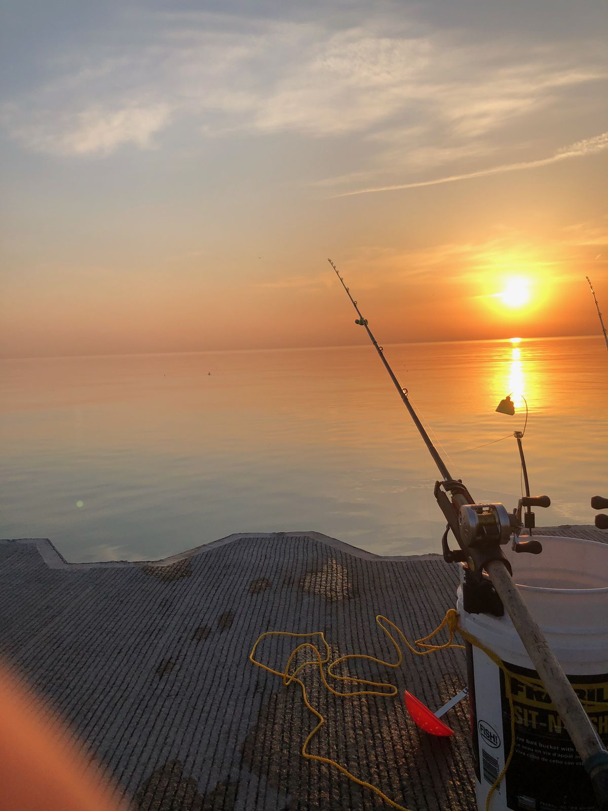 """Fishing sunrise on the Chicago lakefront. Credit: Jason """"Special"""" Le"""