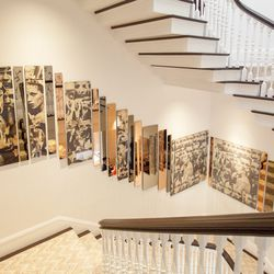 """Jonathan Rachman of Jonathan Rachman Design were inspired by inspired by fashion icon Kate Moss and the song """"Royals"""" by Lorde for the entry hall and main stairway designs."""
