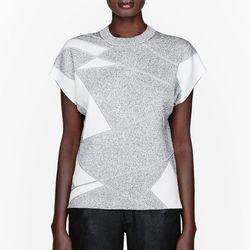 "<a href=""http://www.ssense.com/women/product/helmut_lang/mottled_patchwork_geo_pleat_t-shirt/83483"">Helmut Lang mottled patch work geo pleat tee</a>, $76.80 (was $320)"