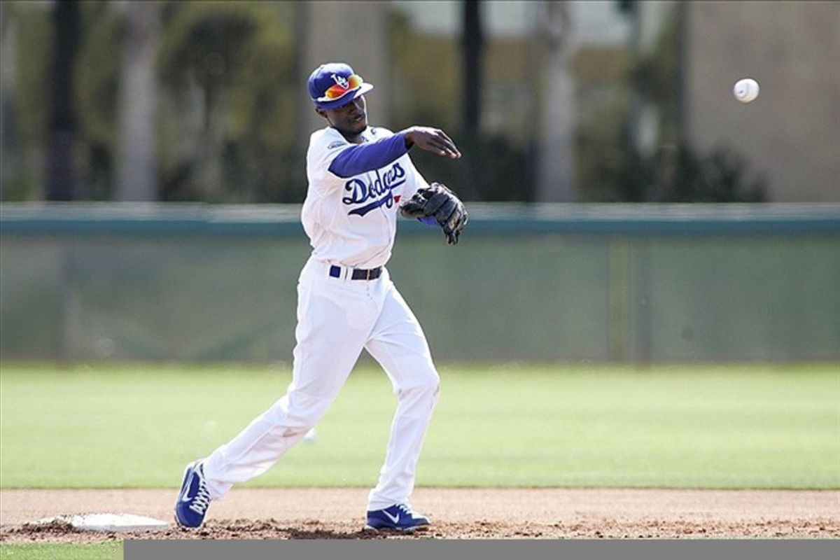 Feb 28, 2012; Glendale, AZ, USA; Los Angeles Dodgers shortstop Dee Gordon (9) throws to first during a workout at Camelback Ranch.  Mandatory Credit: Jake Roth-US PRESSWIRE