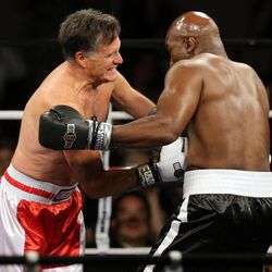 Former Massachusetts Gov. Mitt Romney fights five-time heavyweight champion Evander Holyfield at Charity Vision Fight Night at The Rail Event Center in Salt Lake City on Friday, May 15, 2015.