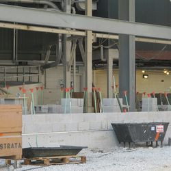 11:15 a.m. Concrete blocks beginning to form the base of the outer bleacher wall -