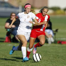 Davis forward Ireland Dunn (2) dribbles the ball downfield against American Fork during the 5A girls soccer playoffs in Kaysville, Thursday, Oct. 15, 2015.