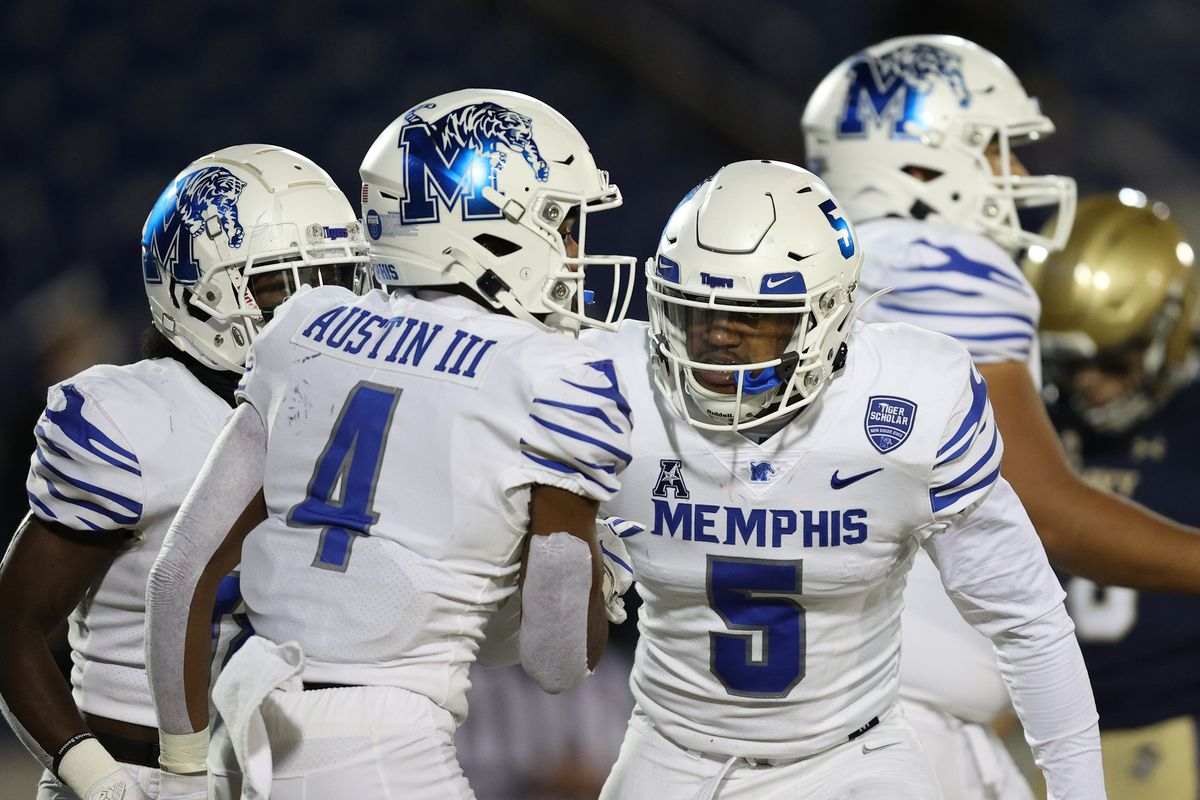 Wide receiver Calvin Austin III #4 of the Memphis Tigers celebrates with teammates after scoring a touchdown against the Navy Midshipmen during the first half at Navy-Marine Corps Memorial Stadium on November 28, 2020 in Annapolis, Maryland.