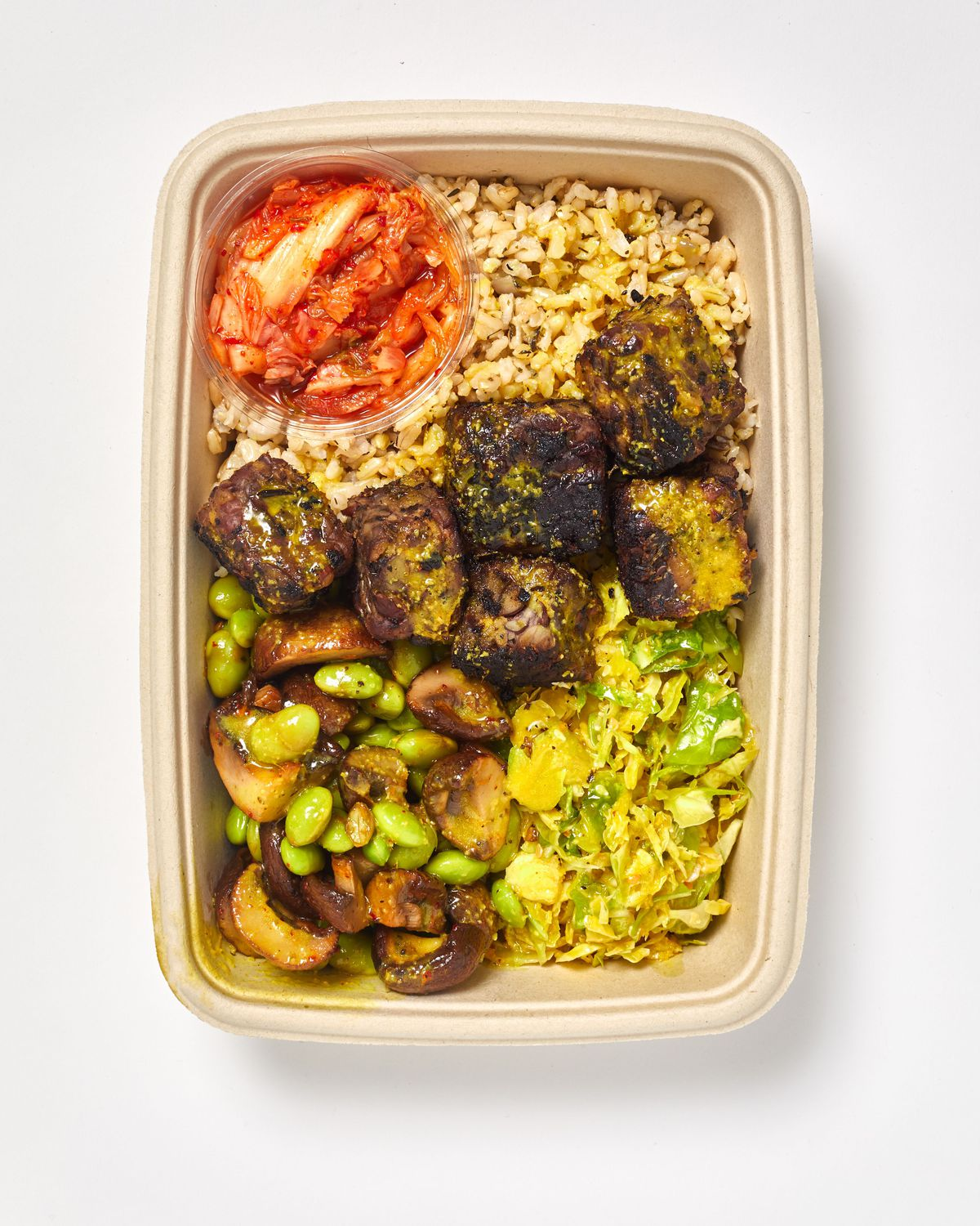 JESSAMINE BROWN RICE, BRUSSELS SPROUTS, MARINATED MUSHROOMS, TEMPEH, KIMCHEE, TURMERIC-GINGER VIN