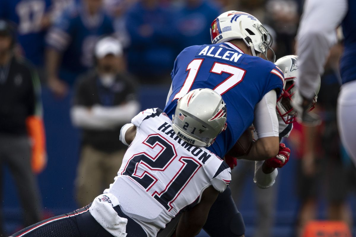 Buffalo Bills quarterback Josh Allen is injured on a tackle by New England Patriots cornerback Jonathan Jones and strong safety Duron Harmon during the third quarter at New Era Field.