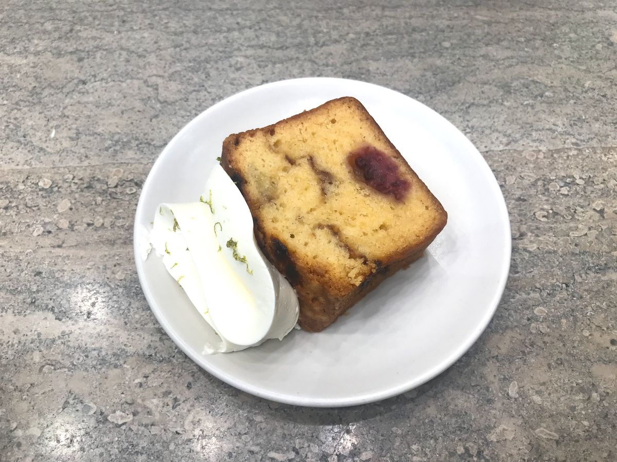 a loaf of blackberry tea cake with lime buttercream