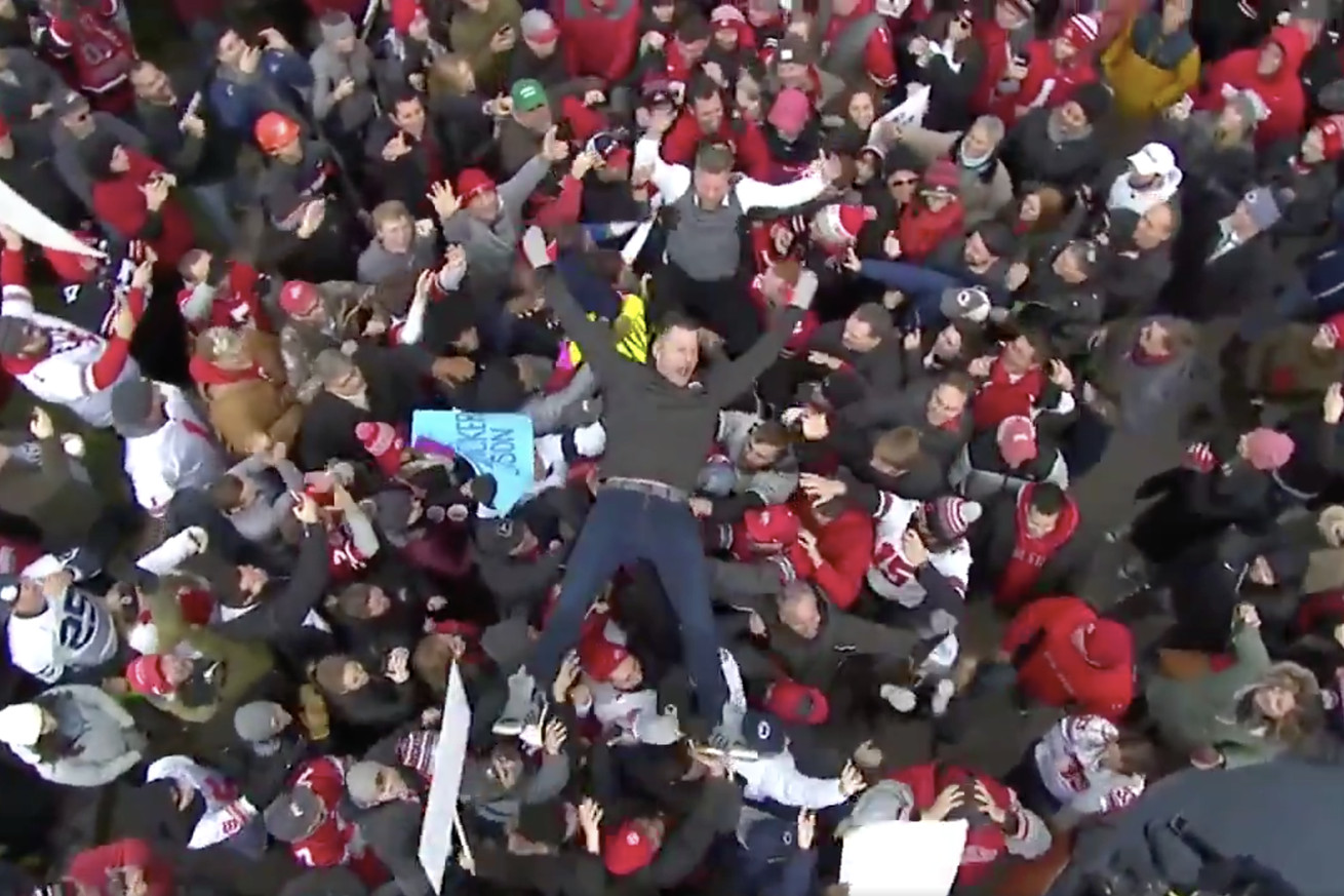 Stipe Miocic goes crowdsurfing at Ohio State game.
