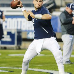 Brigham Young Cougars quarterback Tanner Mangum (12) warms up prior to the game with the Boise State Broncos in Provo on Friday, Oct. 6, 2017.