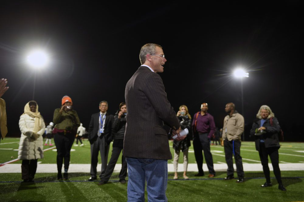 Boasberg addresses school officials, members of the media, and football coaches under the new lights.