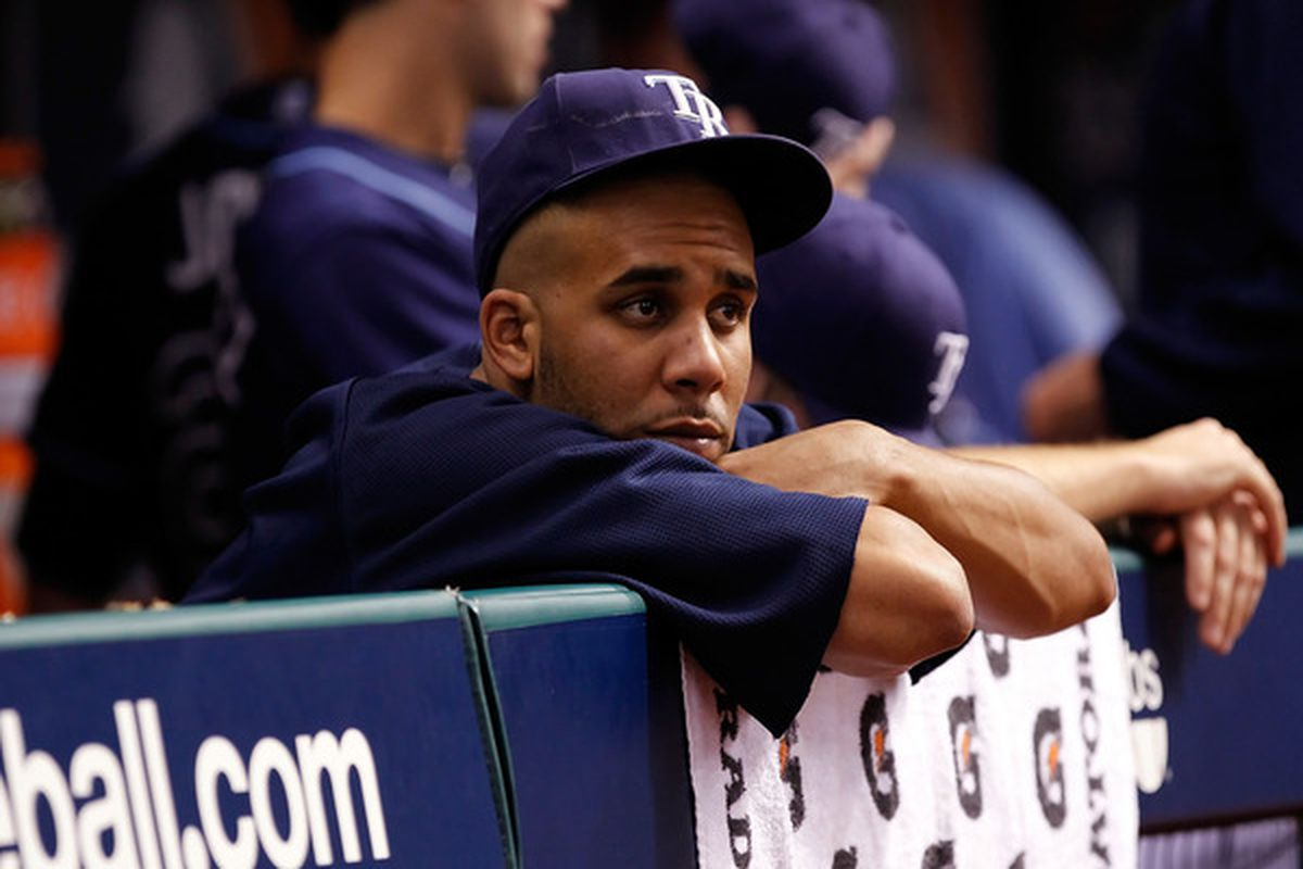 ST. PETERSBURG - OCTOBER 12:  Pitcher David Price #14 of the Tampa Bay Rays watches his team against the Texas Rangers during Game 5 of the ALDS at Tropicana Field on October 12, 2010 in St. Petersburg, Florida.  (Photo by J. Meric/Getty Images)