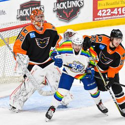 Syracuse Crunch Peter Abbandonato (17) battles for position with Lehigh Valley Phantoms Chris Bigras (27) and goalie Kirill Ustimenko (72) in American Hockey League (AHL) action at the Upstate Medical University Arena in Syracuse, New York on Saturday, February 22, 2020. Syracuse won 2-1.