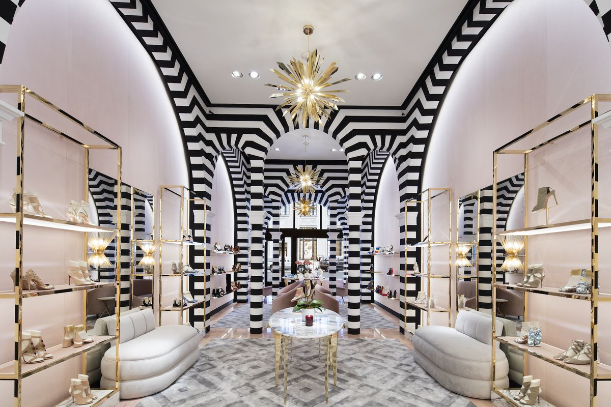 Gold fixtures, black-and-white striped wallpaper inside the Aquazzura store in New York City