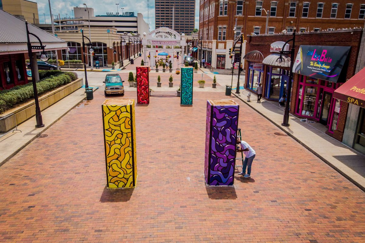 Concrete pillars decorated with public art jut up from the street level at Underground Atlanta.