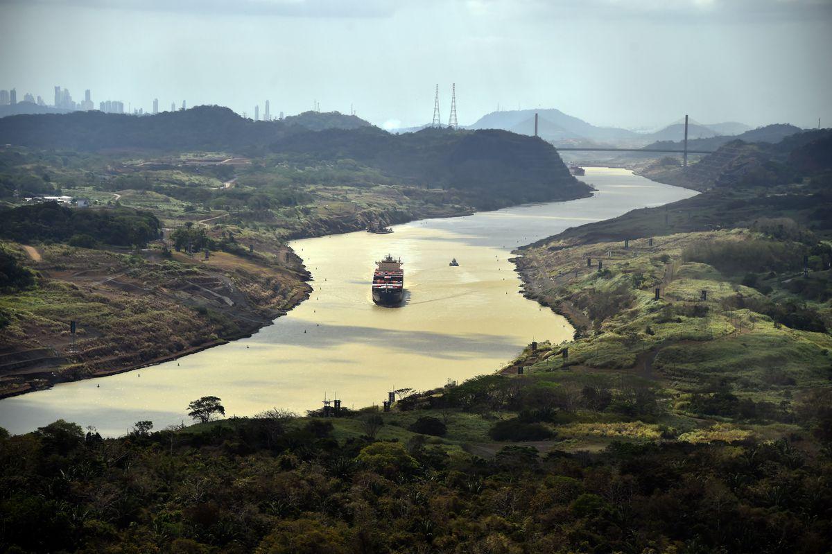 A merchant ship sails along the Panama Canal, on March 23, 2015. | RODRIGO ARANGUA/AFP/Getty Images)