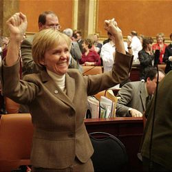 Rep. Julie Fisher, R-Fruit Heights, cheers as the final session of the 2009 Utah Legislature is adjourned at the Capitol Thursday.